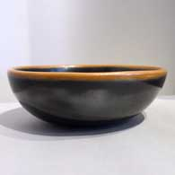 Black bowl with a sienna rim Last month , click or tap to see a larger version
