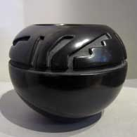 Black jar carved with four panel geometric design  , click or tap to see a larger version