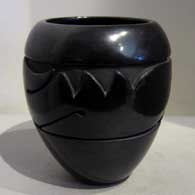 Black jar carved with avanyu design  , click or tap to see a larger version