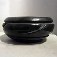 Black bowl carved with geometric design , click or tap to see a larger version