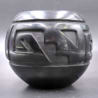 Black jar carved with a four-panel geometric design On sale  , click or tap to see a larger version