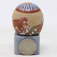 Miniature polychrome seed pot with sgraffito and painted raccoon, fish, stream and geometric design , click or tap to see a larger version