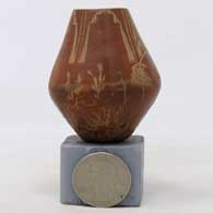 Miniature red jar with sgraffito buffalo, landscape and geometric design , click or tap to see a larger version