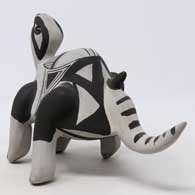 Black on gray dinosaur figure with geometric design , click or tap to see a larger version
