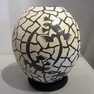 Brown and white jar with sgraffito lizard and web design , click or tap to see a larger version