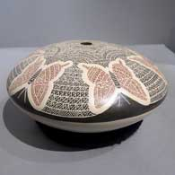 Polychrome seed pot with sgraffito and painted butterfly and geometric design , click or tap to see a larger version