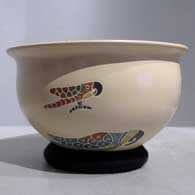 Polychrome bowl with sgraffito and painted parrot and geometric design inside and out , click or tap to see a larger version