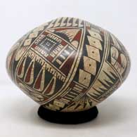 Polychrome seed pot with mixed clay and geometric design , click or tap to see a larger version