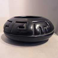 Polished black bowl carved with geometric design On sale , click or tap to see a larger version