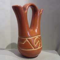 Red wedding vase carved with geometric design Generations , click or tap to see a larger version