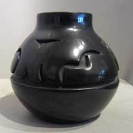 Black jar carved with geometric design , click or tap to see a larger version