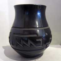 Polished black flare-neck jar carved with geometric design  , click or tap to see a larger version