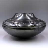 Black jar carved with an avanyu and geometric design  , click or tap to see a larger version