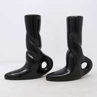 Pair of black candlestick holders in shape of boots carved with twisted stems , click or tap to see a larger version