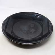Black on black shallow bowl with an avanyu and geometric design , click or tap to see a larger version