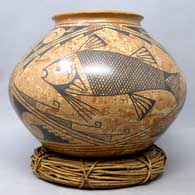 Polychrome jar with black fish and geometric design on mixed clay , click or tap to see a larger version