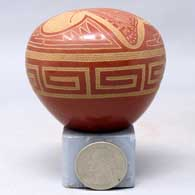 Miniature polychrome seed pot with sgraffito butterfly, scroll and geometric design , click or tap to see a larger version