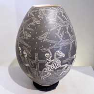 Black and white jar etched in the sgraffito technique with a Night of the Dead motif