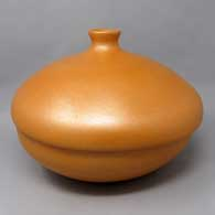 A lidded golden micaceous bean pot