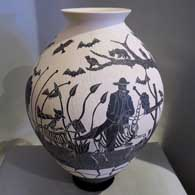 Sgraffito Day of the Dead design on a black and white jar