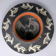 Polychrome jar with Mimbres rabbit and geometric design, inside and out