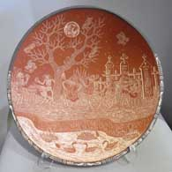 Sgraffito Night of the Dead motif on a red and white bowl