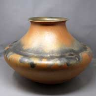 Double shouldered golden micaceous jar with a flared rim and fire clouds