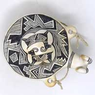Black and white canteen with a bighorn ram's head spout and Mimbres ram and geometric design