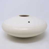 White seed pot with a sculpted Shifting Sands design surface with tiny flecks of mica and an inlaid stone